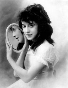 Mabel Normand with a mirror
